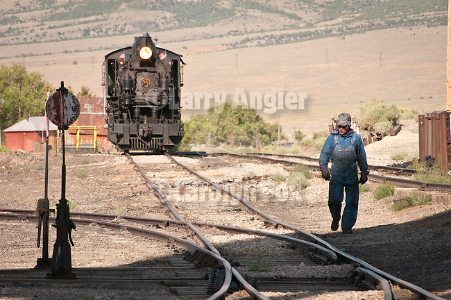 Engineer John Tyson works the switches for No. 93, Nevada Northern Railway, East Ely yards, Nev.
