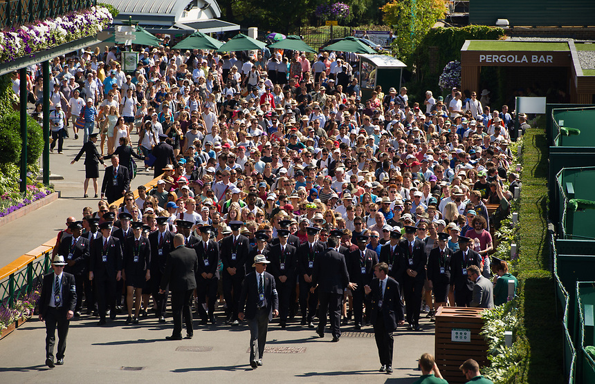 Fans escorted through at the start of Day 3<br /> <br /> Photographer Ashley Western/CameraSport<br /> <br /> Wimbledon Lawn Tennis Championships - Day 3 - Wednesday 5th July 2017 -  All England Lawn Tennis and Croquet Club - Wimbledon - London - England<br /> <br /> World Copyright &not;&copy; 2017 CameraSport. All rights reserved. 43 Linden Ave. Countesthorpe. Leicester. England. LE8 5PG - Tel: +44 (0) 116 277 4147 - admin@camerasport.com - www.camerasport.com
