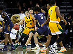 SIOUX FALLS, SD - MARCH 8: Sam Griesel #5 of the North Dakota State Bison tries to get past the defense of Kevin Obanor #0 of the Oral Roberts Golden Eagles at the 2020 Summit League Basketball Championship in Sioux Falls, SD. (Photo by Richard Carlson/Inertia)