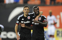 Washington, D.C.- March 29, 2014. Eddie Johnson (7) of D.C. United with Davy Arnaud (8)  D.C. United defeated the New England Revolution 2-0 during a Major League Soccer Match for the 2014 season at RFK Stadium.