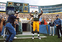 Green Bay Packers defensive end Reggie White is introduced to the fans at Lambeau Field at the start of the game against the San Diego Chargers on September 15, 1996.