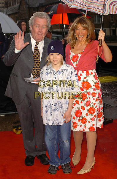 """GUESTS.Arrivals for """"An Audience With Coronation St."""" recording at LWT Studios, London, UK..Ref: CAN.street full length floral print hand waving grey gray blue red .www.capitalpictures.com.sales@capitalpictures.com.©Capital Pictures"""
