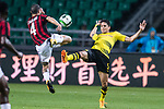 Borussia Dortmund Defender Marc Bartra (R) trips up with AC Milan Midfielder Jose Mauri (L) during the International Champions Cup 2017 match between AC Milan vs Borussia Dortmund at University Town Sports Centre Stadium on July 18, 2017 in Guangzhou, China. Photo by Marcio Rodrigo Machado / Power Sport Images