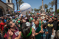 Los Angeles, CA -  Monday, June 23, 2014:  Mexico fans hit a beach ball during halftime of the Mexico vs. Croatia first round match at a public viewing at Plaza Mexico.