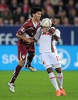 FUSSBALL   1. BUNDESLIGA  SAISON 2011/2012   30. Spieltag FC Augsburg - VfB Stuttgart           10.04.2012 Serdar Tasci (li, VfB Stuttgart) gegen Nando Rafael (FC Augsburg)