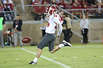 Washington State punter, Oscar Draguicevich, punts during the Cougs big road victory over the Stanford Cardinal.
