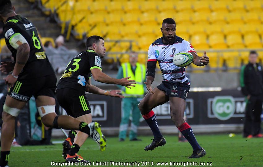 Marika Koroibete takes a pass under pressure from James Marshall during the Super Rugby match between the Hurricanes and Rebels at Westpac Stadium in Wellington, New Zealand on Saturday, 4 May 2019. Photo: Dave Lintott / lintottphoto.co.nz