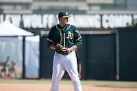 Oakland Athletics relief pitcher Clark Cota (57) gets ready to deliver a pitch during an Instructional League game against the Chicago White Sox at Lew Wolff Training Complex on October 5, 2018 in Mesa, Arizona. (Zachary Lucy/Four Seam Images)
