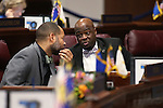 Nevada Senate Democrats Aaron Ford, left, and Kelvin Atkinson work on the Senate floor at the Legislative Building in Carson City, Nev., on Thursday, April 9, 2015. <br /> Photo by Cathleen Allison