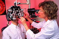 Professional woman optometrist giving eye exam
