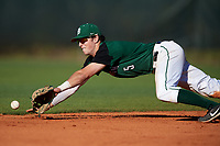 Dartmouth Big Green shortstop Nate Ostmo (5) makes a diving attempt on a base hit during a game against the Northeastern Huskies on March 3, 2018 at North Charlotte Regional Park in Port Charlotte, Florida.  Northeastern defeated Dartmouth 10-8.  (Mike Janes/Four Seam Images)