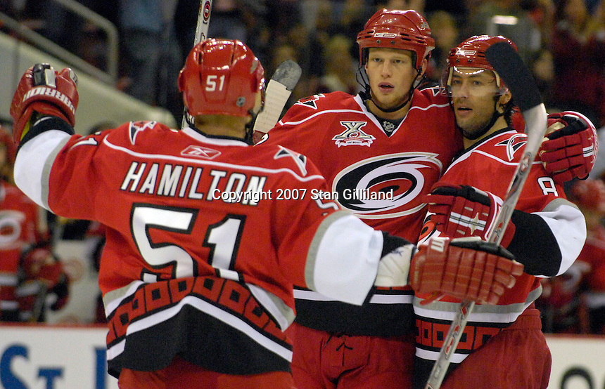 The Carolina Hurricanes' Eric Staal (center) celebrates his goal against the Philadelphia Flyers with teammates Jeff Hamilton (55) and Matt Cullen (8), who both had an assist on the goal during their game Wednesday, Nov. 21, 2007 in Raleigh, NC. The Flyers won 6-3.