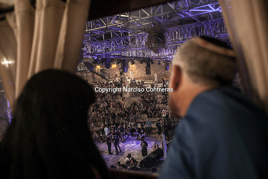 August 27, 2014 - Binyamina, Haifa District, Israel: The parents of one of the musicians at Orphaned Land heavy metal band, look at the anphitheatre from the backstage before the band performs a concert in Binyamina Amphitheatre at north of Israel. Orphaned Land is a music band founded by Jewish and Arabian musicians who combine ethnic music with rock metal as they recite verses in Hebrew and Arabic from the sacred Quram and Tora Scriptures. (Narciso Contreras/Polaris)