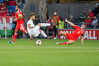 Levan Mchedlidze of Georgia tangles with James Chester of Wales during the FIFA World Cup Qualifier match between Wales and Georgia at the Cardiff City Stadium, Cardiff, Wales on 9 October 2016. Photo by Mark  Hawkins / PRiME Media Images.