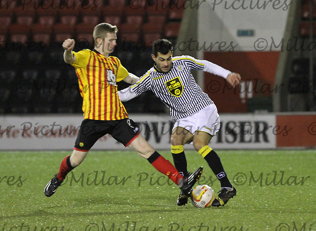 Dominic Docherty tackling Mo Yaqub in the Partick Thistle v St Mirren Scottish Professional Football League Development League match played at the Excelsior Stadium, Airdrie on 26.1.15.