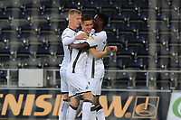 Kristoffer Peterson (centre) of Swansea City celebrates scoring the opening goal during the Carabao Cup Second Round match between Swansea City and Cambridge United at the Liberty Stadium in Swansea, Wales, UK. Wednesday 28, August 2019.