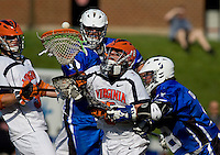 Adam Ghitelman (8) of Virginia tries to save the ball away from Max Quinzani (8) and Tom Montelli (11) of Duke during the ACC men's lacrosse tournament semifinals in College Park, MD.  Virginia defeated Duke, 16-12.