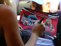 Aug. 3, 2014; Kent, WA, USA; NHRA funny car driver Courtney Force signs autographs during the Northwest Nationals at Pacific Raceways. Mandatory Credit: Mark J. Rebilas-USA TODAY Sports