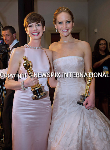 Jennifer Lawrence Best Actress and Anne Hathaway Best Supporting Actress.OSCARS Backstage- 85th Annual Academy Awards, Dolby Theatre, Hollywood_24/02/2013.MANDATORY PHOTO CREDIT: ©Ampas/NEWSPIX INTERNATIONAL . .(Failure to by-line the photograph will result in an additional 100% reproduction fee surcharge. You must agree not to alter the images or change their original content)..            *** ALL FEES PAYABLE TO: NEWSPIX INTERNATIONAL ***..IMMEDIATE CONFIRMATION OF USAGE REQUIRED:Tel:+441279 324672..Newspix International, 31 Chinnery Hill, Bishop's Stortford, ENGLAND CM23 3PS.Tel: +441279 324672.Fax: +441279 656877.Mobile: +447775681153.e-mail: info@newspixinternational.co.uk