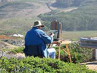 Bay area artist Edwin Bertolet applies brush to canvas at Pescadero State Beach on the California coast