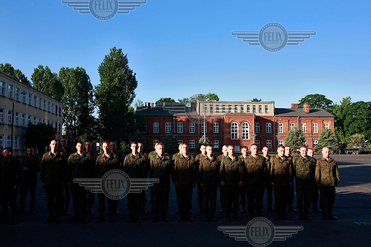 Soldiers standing for early morning assembly. This year's class of drafted recruits is the final one after 90 years of compulsory military service, as Poland's army turns professional in 2009.