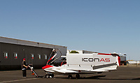 An ICON A5 with folded wings at ICON Aircraft headquarters at the Nut Tree airport (VCB) in Vacaville, Solano County, California is being towed back into the hangar after a flight.<br />