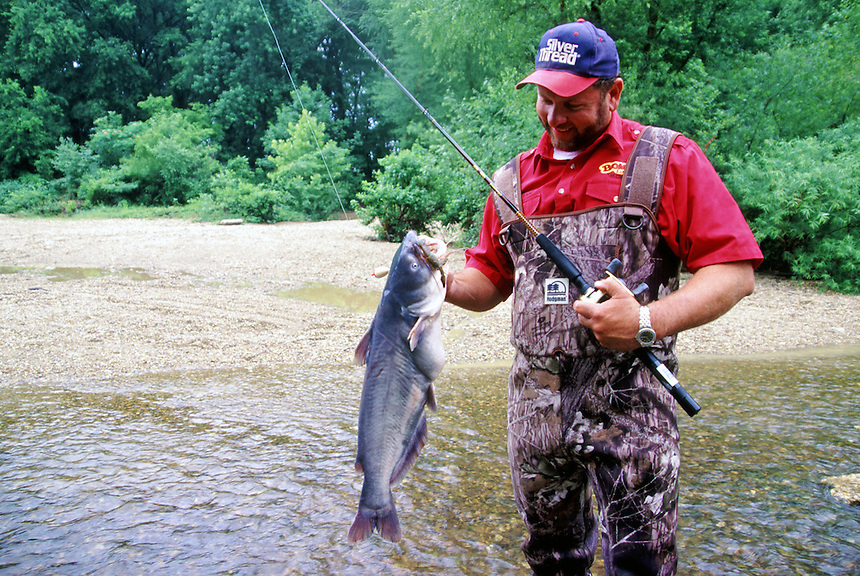 Angler with blue catfish caught in Saline River near Benton, Arkansas
