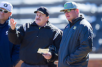 Marshall Thundering Herd head coach Jeff Waggoner (right) listens as home plate umpire Randy Vestal goes over the grounds rules prior to the game against the Georgetown Hoyas at Wake Forest Baseball Park on February 15, 2014 in Winston-Salem, North Carolina.  The Thundering Herd defeated the Hoyas 5-1.  (Brian Westerholt/Four Seam Images)