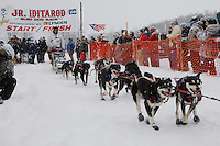 Patrick Mackey of Kasilof leaves the start line of the 2009 Junior Iditarod on Knik Lake on Saturday Februrary 28, 2009.