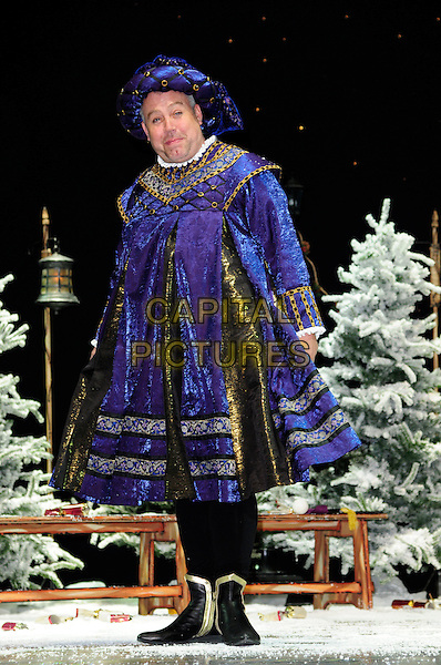 CLIFF PERISAL.First Family Entertainment theatre company's annual group Pantomime photocall at Piccadilly Theatre, London, England..November 26th, 2010.stage costume panto pantomime full length black gold purple blue top henry VIII 8th.CAP/CAS.©Bob Cass/Capital Pictures.