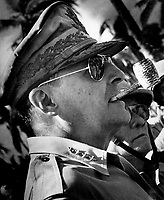 "1944 - Exact Date Shot Unknown - General MacArthur surveys the beachhead on Leyte Island, soon after American forces swept ashore from a gigantic liberation armada into the central Philippines, at the historic moment when the General made good his promise ""I shall return"".  1944. (Coast Guard)"
