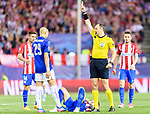 Referee Jonas Eriksson shows the yellow card to Yohan Benalouane of Leicester City during their 2016-17 UEFA Champions League Quarter-Finals 1st leg match between Atletico de Madrid and Leicester City at the Estadio Vicente Calderon on 12 April 2017 in Madrid, Spain. Photo by Diego Gonzalez Souto / Power Sport Images