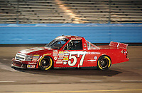 Nov. 13, 2009; Avondale, AZ, USA; NASCAR Camping World Truck Series driver Norm Benning during the Lucas Oil 150 at Phoenix International Raceway. Mandatory Credit: Mark J. Rebilas-