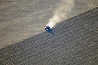 tractor tilling field