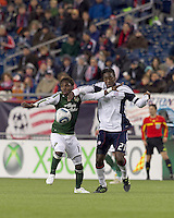Portland Timbers midfielder Kalif Alhassan (11) and New England Revolution midfielder Shalrie Joseph (21) battle for the ball. In a Major League Soccer (MLS) match, the New England Revolution tied the Portland Timbers, 1-1, at Gillette Stadium on April 2, 2011.