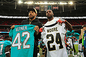 1st October 2017, Wembley Stadium, London, England; NFL International Series, Game Two; Miami Dolphins versus New Orleans Saints; Alterraun Verner of the Miami Dolphins and Sterling Moore of the New Orleans Saints exchange shirts