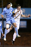 01 November 2012: UNC's Jordan Gafa (14) and Boston College's Nick Corliss (NZL) (5) challenge for a header. The University of North Carolina Tar Heels played the Boston College Eagles at Fetzer Field in Chapel Hill, North Carolina in a 2012 NCAA Division I Men's Soccer game. UNC defeated Boston College 4-0.