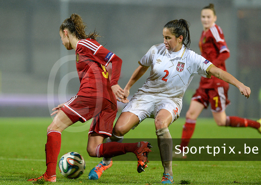 20151130 - LEUVEN ,  BELGIUM : Belgian Tessa Wullaert (left) pictured trying to escape Serbian Jasna Djordjevic (r) during the female soccer game between the Belgian Red Flames and Serbia , the third game in the qualification for the European Championship in The Netherlands 2017  , Monday 30 November 2015 at Stadion Den Dreef  in Leuven , Belgium. PHOTO DAVID CATRY
