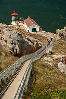 The Point Reyes Lighthouse and tower sit on a rock outcropping above the cold Pacific Ocean, Marin County, California