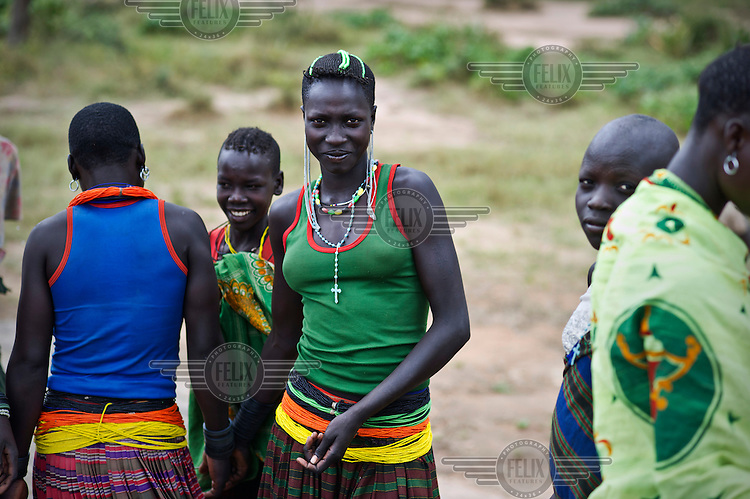 Women from the Karamojong community in traditional clothing and decoration.