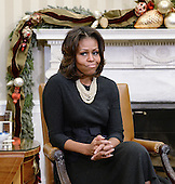 First lady Michelle Obama meets with mothers in the Oval Office to promote the president's health care law in the White House December 18, 2013 in Washington, DC. The Wednesday's meeting focused on ways the law can benefit families. <br /> Credit: Olivier Douliery / Pool via CNP
