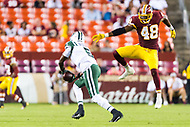 Landover, MD - August 16, 2018: Washington Redskins linebacker Vontae Diggs (48) jumps and misses New York Jets quarterback Teddy Bridgewater (5) during preseason game between the New York Jets and Washington Redskins at FedEx Field in Landover, MD. (Photo by Phillip Peters/Media Images International)