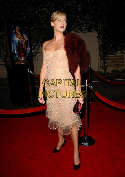 "CHARLIZE THERON. World Premiere of ""Aeon Flux"" held at The Arclight Cinerama Dome in Hollywood, California  .December 1st, 2005.Ref: DVS.full length beige dress burgundy fur wrap shawl strapless clutch purse sheer.www.capitalpictures.com.sales@capitalpictures.com.Supplied By Capital PIctures"