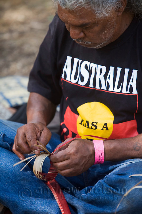 An indigenous man weaving handicrafts at the Laura Aboriginal Dance Festival.  Laura, Queensland, Australia