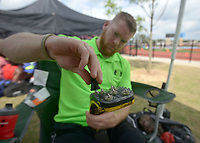 NWA Democrat-Gazette/BEN GOFF @NWABENGOFF<br /> Cody Johnson of Bigelow installs new spikes on his running prosthetic leg Thursday, April 20, 2017, before competing in the 100 meter and 200 meter dash at the Never Say Never Foundation's Battle of the Blades at the McDonald Relays at Fort Smith Southside. The meet is Johnson's second after returning to running, on a new prosthetic leg, five months ago.