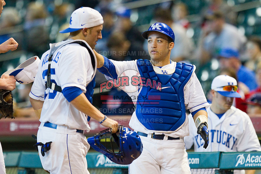 Catcher Michael Thomas #42 of the Kentucky Wildcats greets his teammates as the come off the field after the top of the first inning against the Houston Cougars at Minute Maid Park on March 5, 2011 in Houston, Texas.  Photo by Brian Westerholt / Four Seam Images
