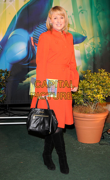 NICKI CHAPMAN.Arrivals at Cirque du Soleil's Varekai gala opening night at the Royal Albert Hall, London, England. .January 5th, 2009.full length nikki nicky red coat jacket black boots bag purse .CAP/CAN.©Can Nguyen/Capital Pictures.