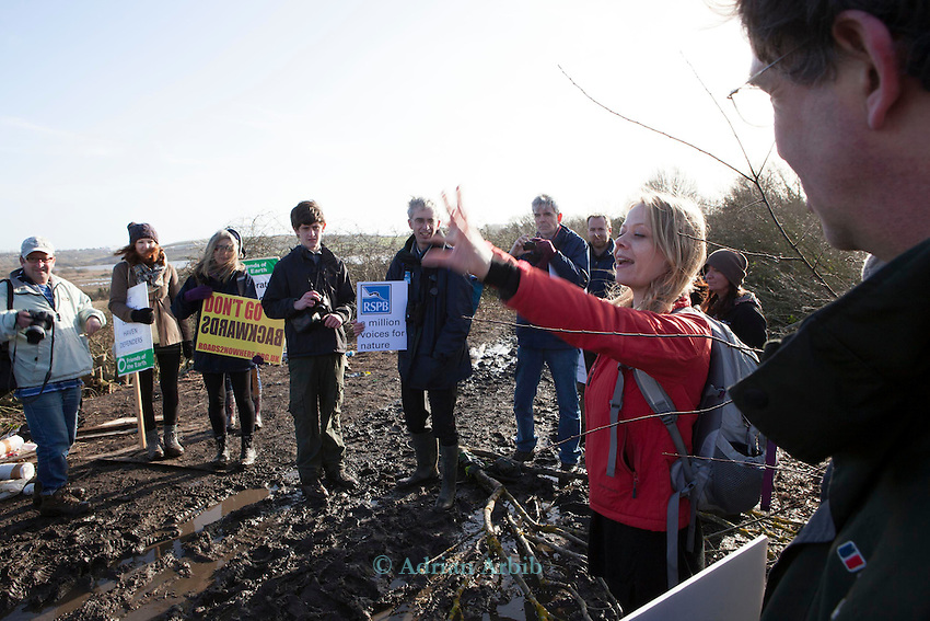 Sian Berry of  CBT  talks to supoprters of the fight against the  Bexhill -Hastings link road /<br /> On Sunday 27 January, senior staff from six major environment and conservation groups will visit the Combe Haven valley, site of the planned Bexhill to Hastings Link Road.<br /> <br /> The heads of Greenpeace, Friends of the Earth, The Wildlife Trusts and the Campaign for Better Transport will join with senior colleagues from RSPB and Campaign to Protect Rural England (CPRE) to see first-hand the area threatened by the planned road and the impact contractors works have already caused. They will also meet protestors taking part in the high profile campaign against its construction and highlight the impacts and threats from the Government's forthcoming roads strategy.