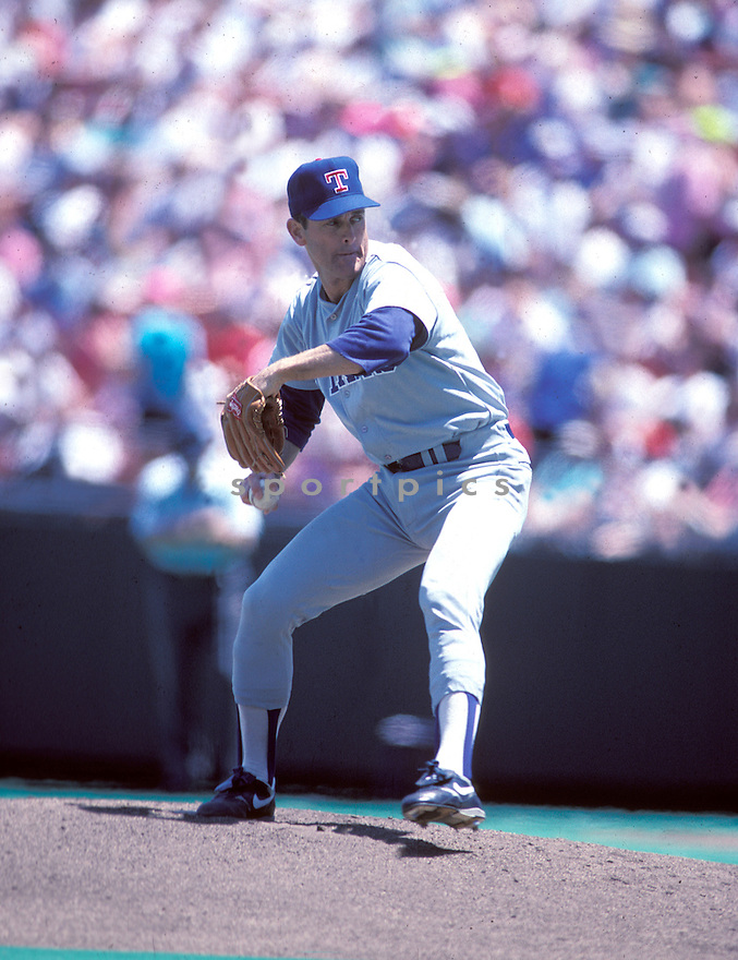 Texas Rangers Nolan Ryan(34) in action during a game from his career. Nolan Ryan played for 27 years with four different teams and was inducted to the Baseball Hall of Fame in 1999.David Durochik/SportPics