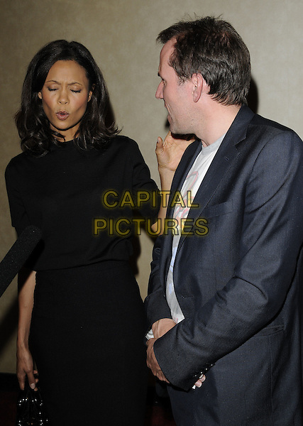 """Thandie Newton & Ben Miller .The """"Huge"""" UK premiere, Empire Cinema, London, England..June 27th, 2011.half length grey gray black suit jacket white  t-shirt dress profile eyes closed funny mouth open.CAP/CAN.©Can Nguyen/Capital Pictures."""